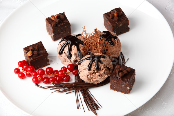 Chocolate ice cream with bonbons and red currants Stock photo © d13