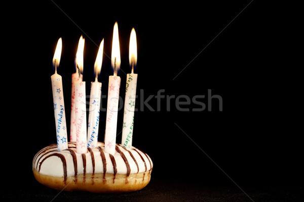 Many candles on doughnut. Stock photo © d13