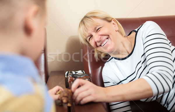Stock photo: Grandmother playing with young boy