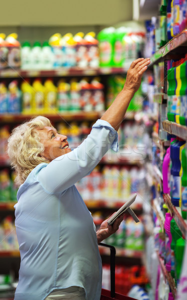 Woman buying household detergents in the shop Stock photo © d13