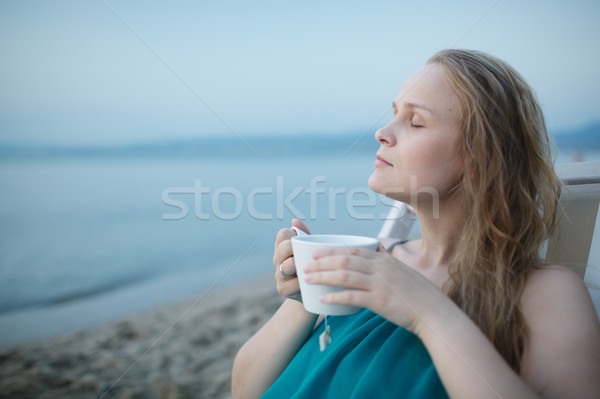 Woman with closed eyes enjoying a cup of tea Stock photo © d13