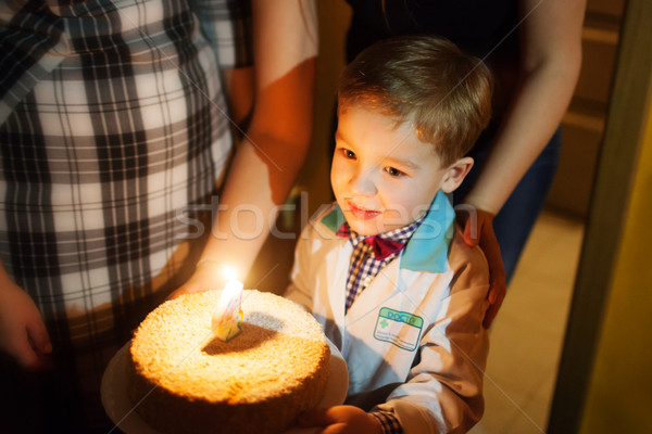 Little boy carrying birthday cake Stock photo © d13