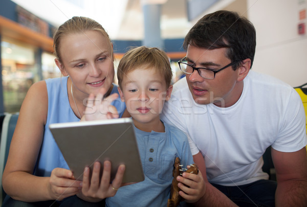Parents and son with tablet PC at the airport Stock photo © d13