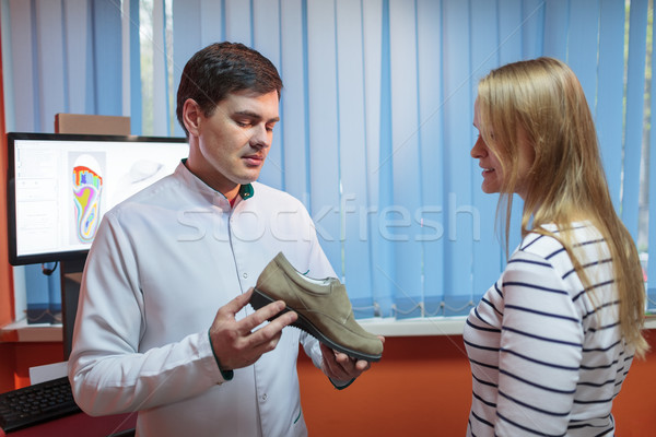 Woman consulting foot doctor Stock photo © d13