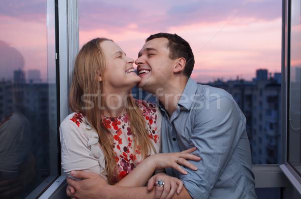 Fiatal pér erkély átkarol nevet játékos magas Stock fotó © d13
