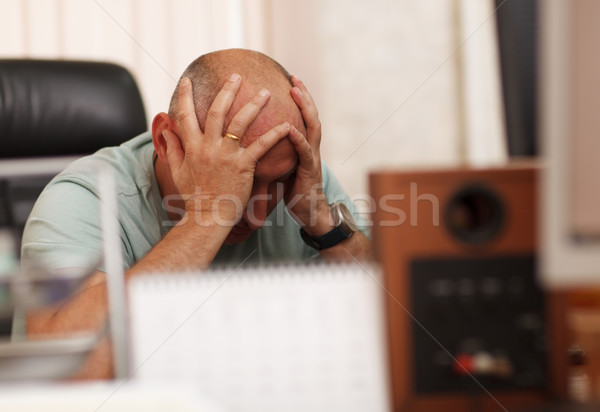 Problems at work or headache Stock photo © d13