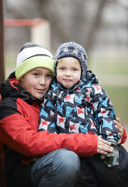 Two adorable young brothers outdoors in winter Stock photo © d13