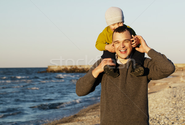 Laughing father giving his sonny a piggy back Stock photo © d13