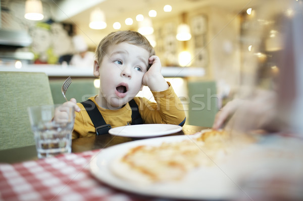 Young boy yawning as he waits to be fed Stock photo © d13