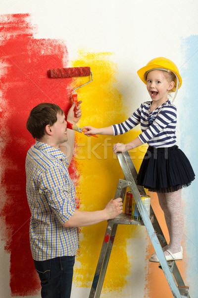Family fun during wall painting Stock photo © d13