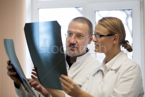 Professor and young doctor comparing x-rays Stock photo © d13