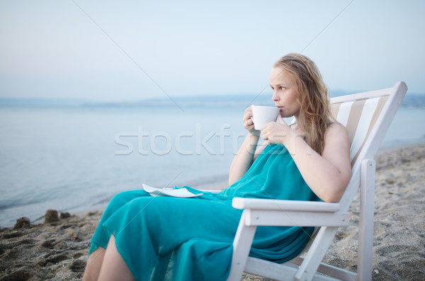 Woman enjoying a cup of tea at the seaside Stock photo © d13