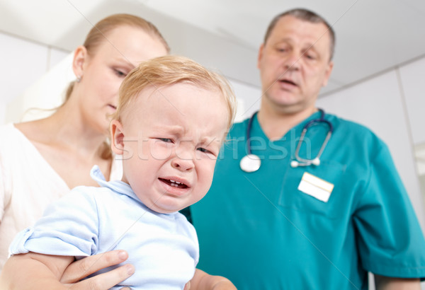 Boy is frightened and crying in a medical study. Stock photo © d13