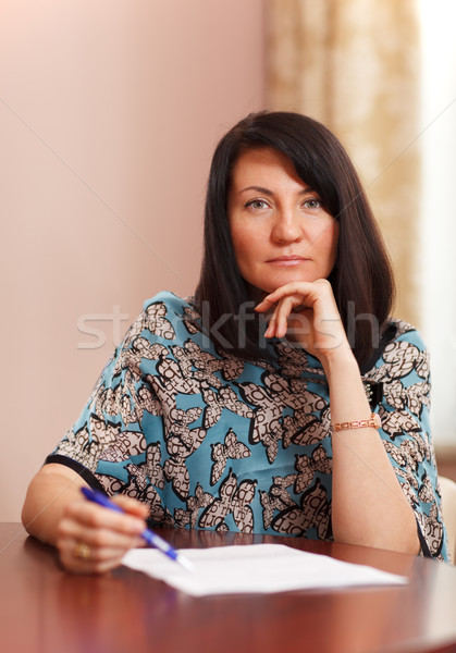 Attractive middle-aged woman working at home Stock photo © d13