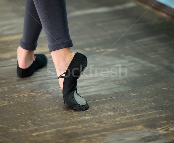 Close up view to ballerinas legs in pointes on wooden floor Stock photo © d13