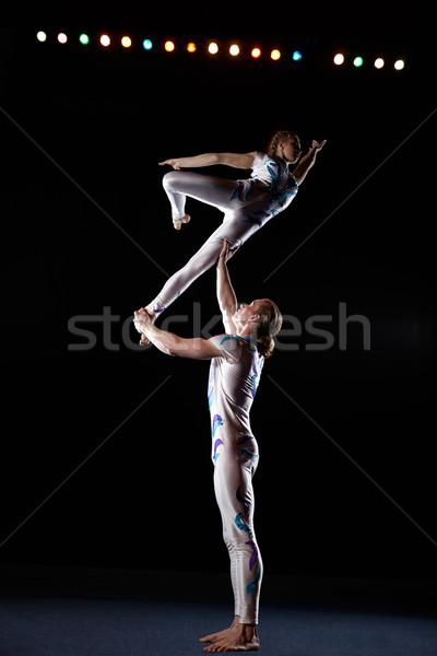 Circus artists perform different tricks. Stock photo © d13