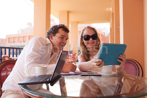 Young couple relaxing over coffee on a balcony Stock photo © d13