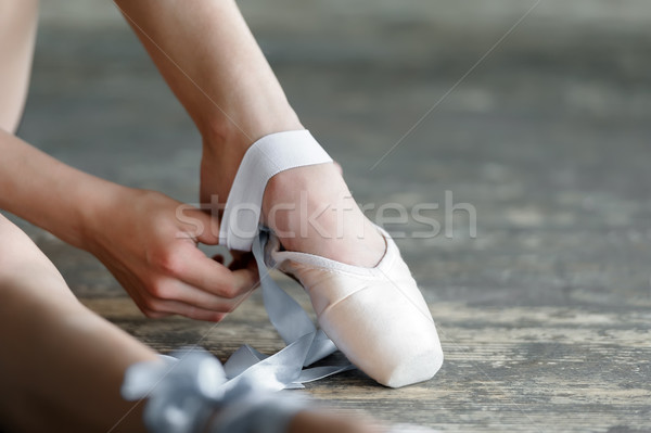 Taking off the ballet shoes after rehearsal or performance Stock photo © d13