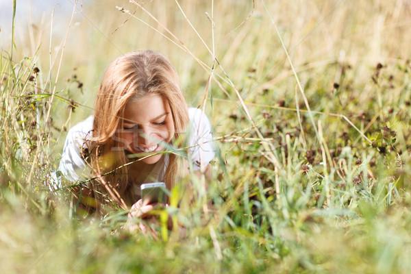 девушки Дать sms телефон трава красивая девушка Сток-фото © d13