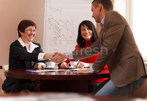 Business man and woman shaking hands Stock photo © d13