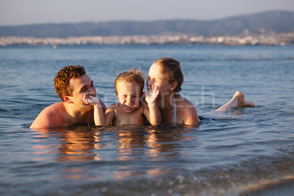 Laughing little boy with his parents at the sea Stock photo © d13