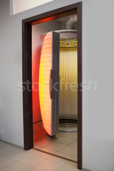 Stand up tanning bed Stock photo © d13