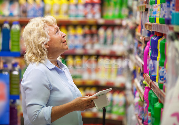 Woman with pad shopping for household detergents Stock photo © d13