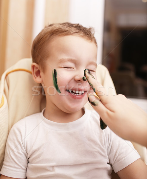 Little boy laughing as his mother paints his face Stock photo © d13