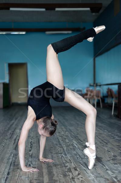 Young ballet dancer practising in the studio Stock photo © d13