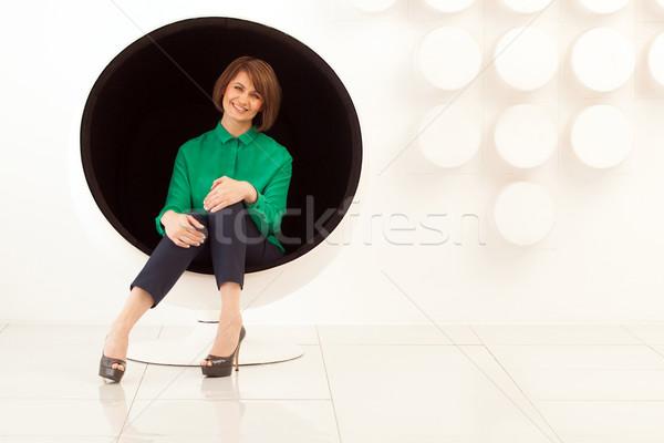 Vonzó nő ül gömb alakú szék kezek vonzó Stock fotó © d13