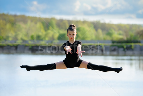 Young Gymnast is Up in the Air Doing Leg-Split Stock photo © d13