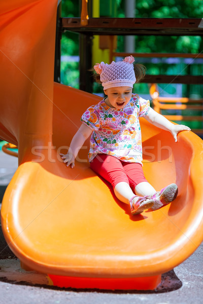 Small girl having fun on a slide Stock photo © d13