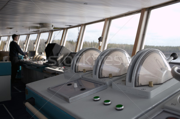 Navigational officer driving ship on the river. Stock photo © d13