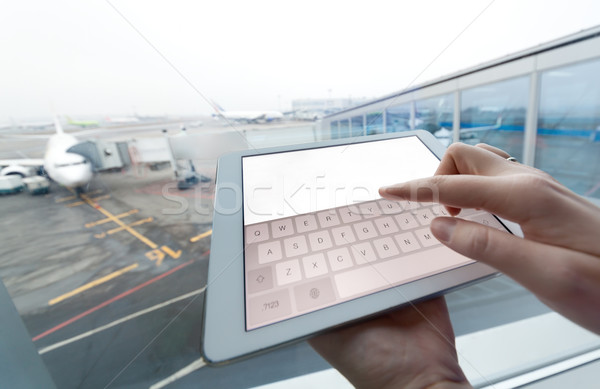 Woman with tablet computer empty screen at airport Stock photo © d13