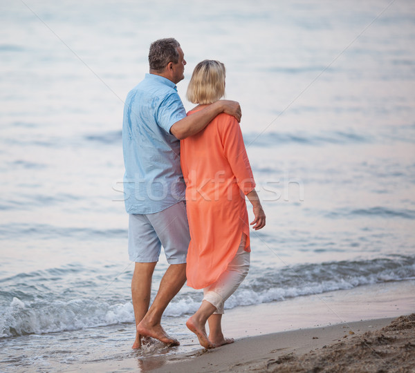 Senior couple enjoying barefoot walk at the seaside Stock photo © d13