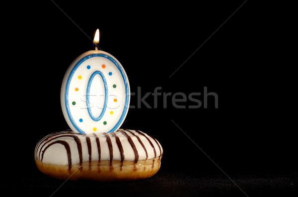 Candle o in the doughnut. New beginnings. Stock photo © d13