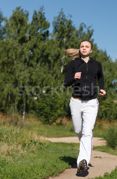 Girl running in the park. Wide shot Stock photo © d13