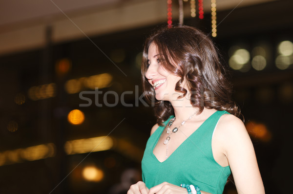 Laughing beautiful young woman in a club Stock photo © d13