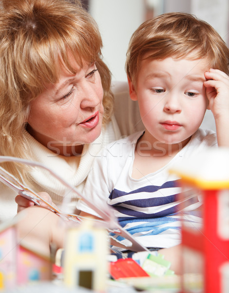 Grandma and puzzled boy Stock photo © d13