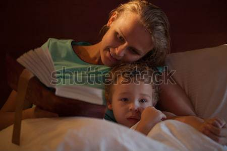 Mother reading a bedtime story to her little son Stock photo © d13