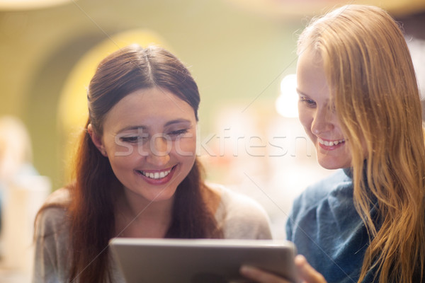 Happy young girls spending time with pad Stock photo © d13