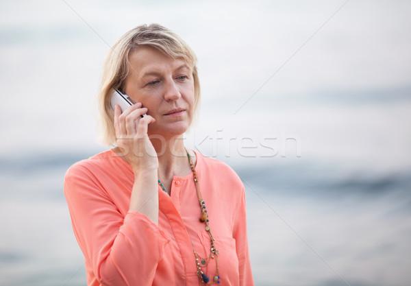 женщину телефон говорить Открытый старший Сток-фото © d13