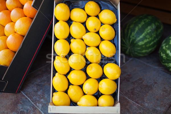 Fresh lemons in an open cardboard box for sale Stock photo © d13
