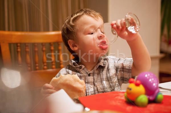 Young boy enjoying lunch Stock photo © d13