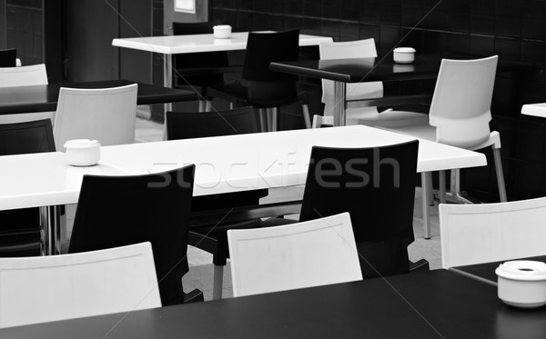 Street small cafe with bw tables and chairs. Stock photo © d13