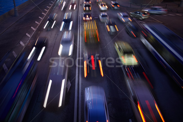 Car traffic at night. Motion blurred background. Stock photo © d13