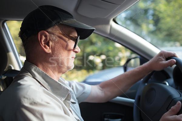 Starszy człowiek koła widok z boku starszych okulary Zdjęcia stock © d13