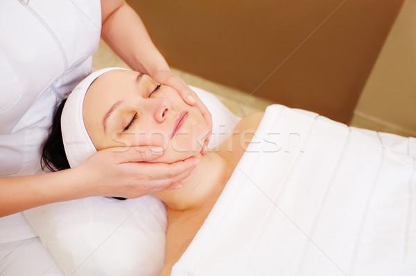 Woman taking facial treatments at beauty spa Stock photo © d13