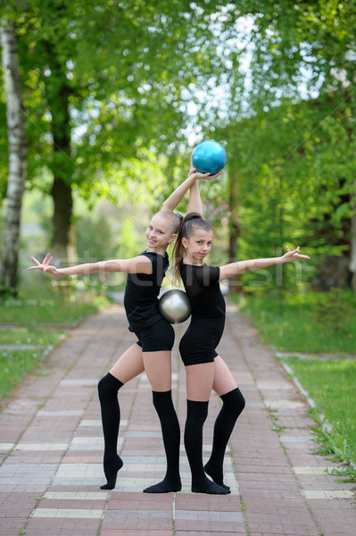 Gymnast girls posing with balls outdoor Stock photo © d13