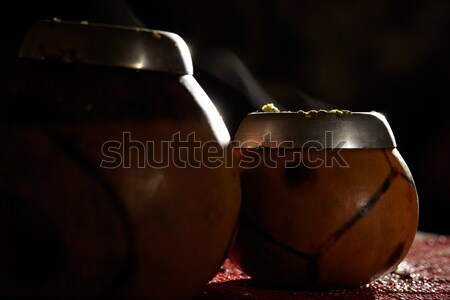 Two yerba mate calabashes with smoke. Stock photo © d13